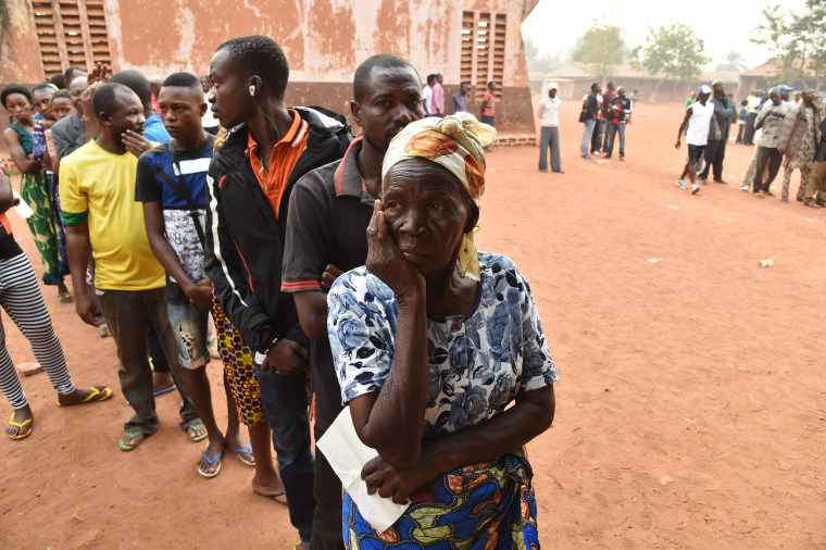 Image: A woman waits to cast her vote at a polling station in Bangui