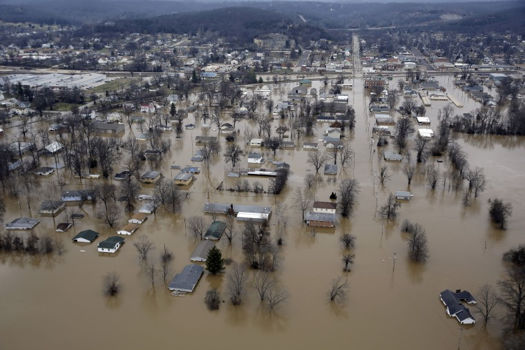 Image: Floodwater surrounds homes and businesses in Pacific, Mo.