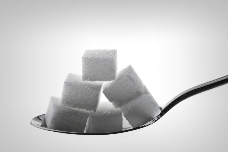 spoon with lump sugar