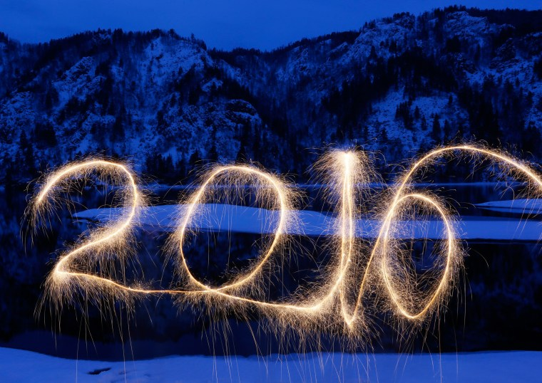 "Image: The numbers ""2016"" are written in the air with a sparkler on a bank of the Yenisei River in the Taiga district, near Divnogorsk"