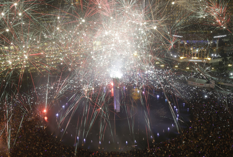 Image: Fireworks explode as thousands of people gather in Jakarta