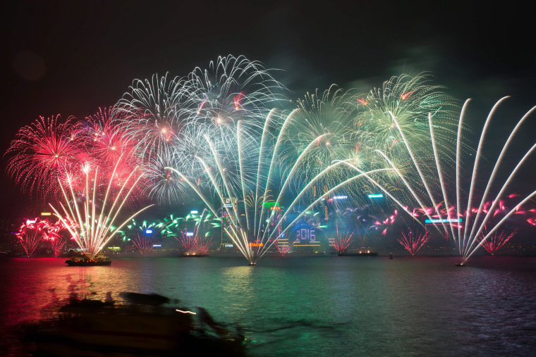 Image: Fireworks explode over Victoria Harbour in Hong Kong