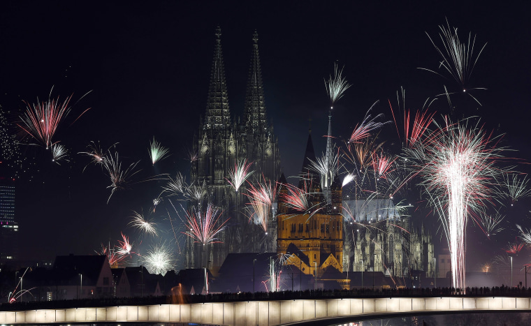 Image: Fireworks explode over the Rhine river