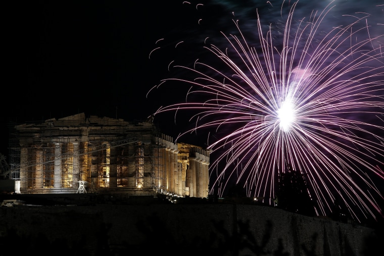 Image: Fireworks explode over the temple of the Parthenon