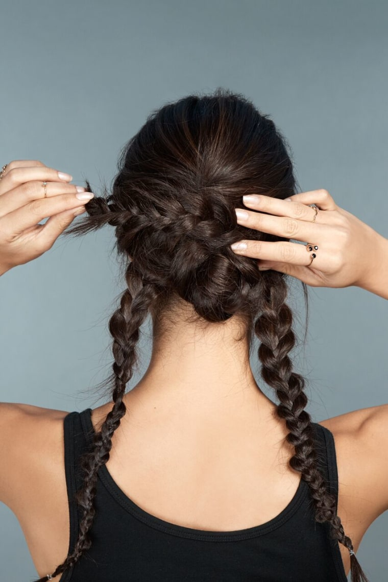 4)	Take the middle braid and wrap it counterclockwise until you create a bun.