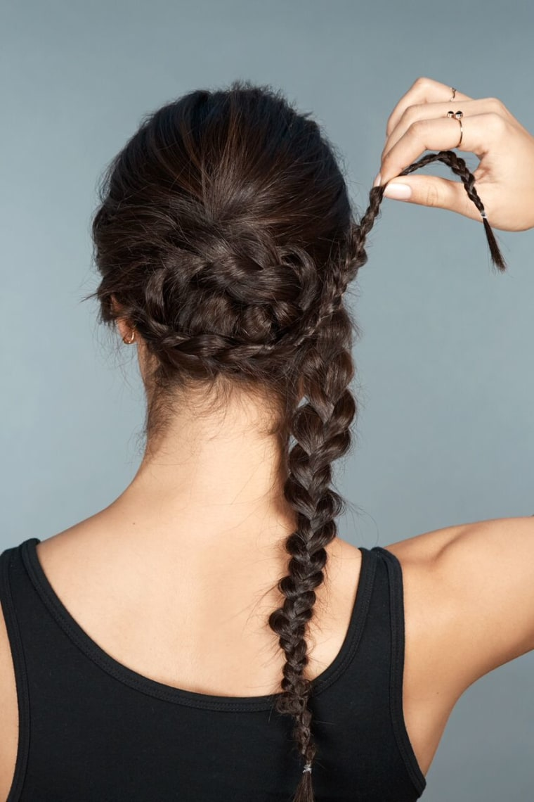 5)	Take the braid on one side and wrap it around the exterior of the bun.