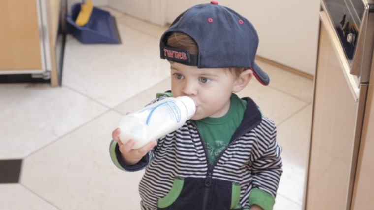 Toddler drinking out of a bottle