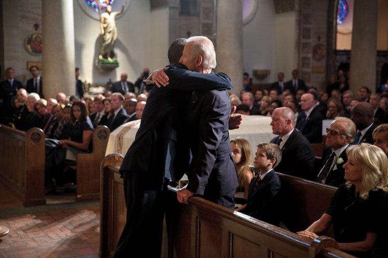 Barack Obama hugs Joe Biden at the June 6, 2015 funeral of Beau Biden