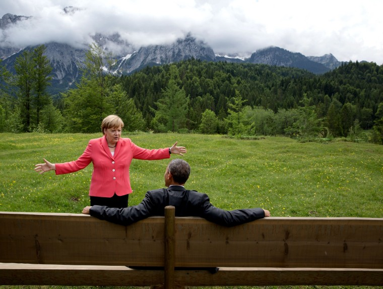 Angela Merkel talks with Barack Obama