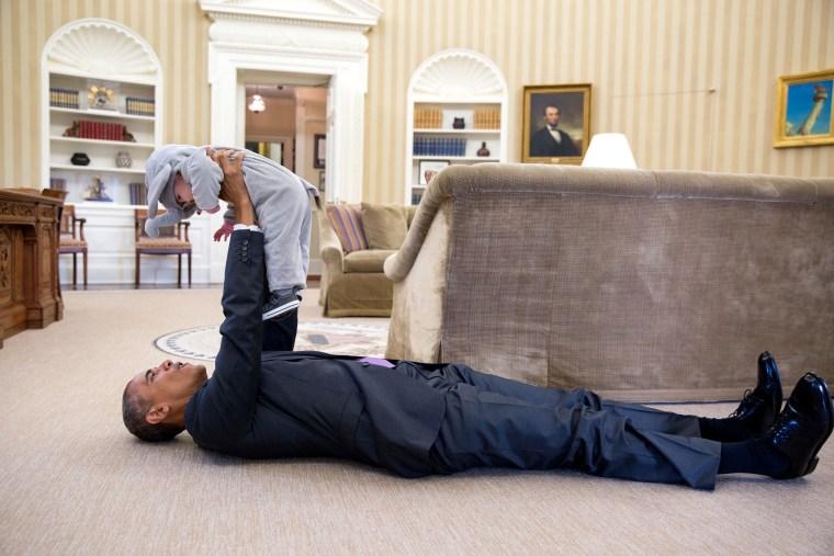 Barack Obama lifts Ella Rhodes, daughter of Deputy National Security Adviser Ben Rhodes