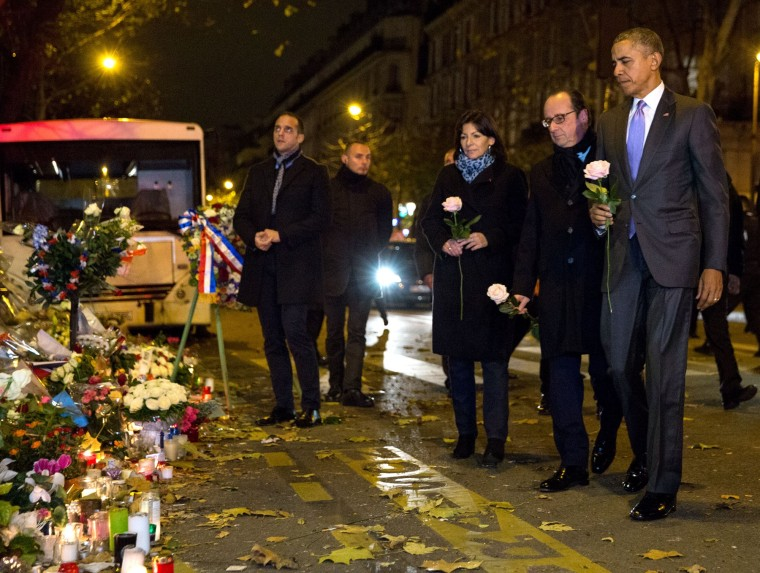 Barack Obama with French President Francois Hollande at a memorial after the Paris terrorist attack