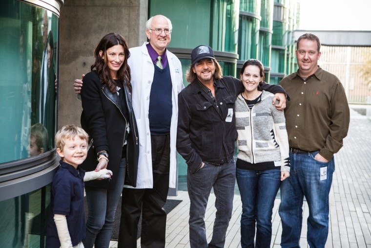 Pearl Jam's Eddie Vedder, his wife Jill with Mikey Fullmer and his parents, and Dr. Alan Lane. Ryan Fullmer and Jill Vedder are childhood friends and with their spouses, co-founders of the EB Research Partnership.
