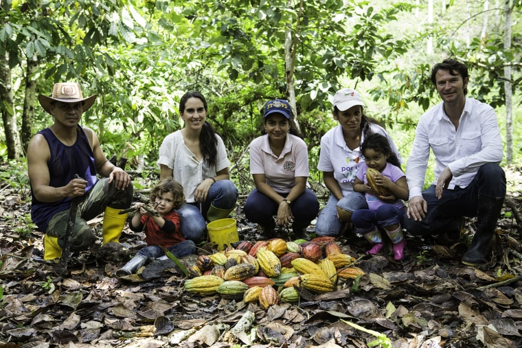 Santiago Peralta and his wife Carla Barboto, founder of the chocolate maker Pacari, with cacao farmers in Ecuador.