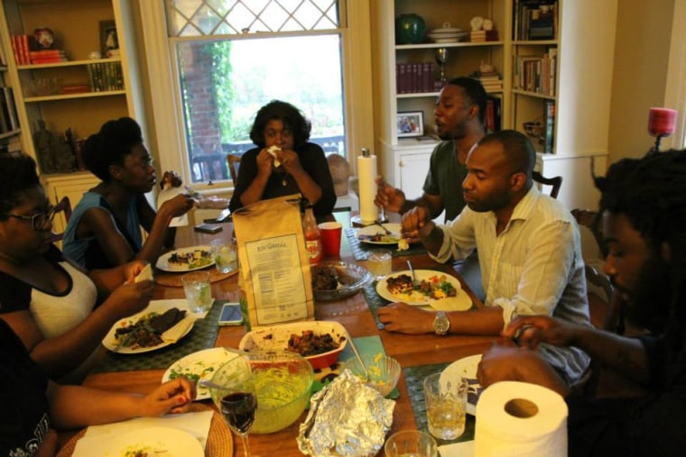 Members of the Rhode Island Writers Colony share a meal.