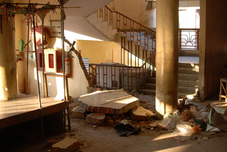 Image: The damaged interior of a market is seen