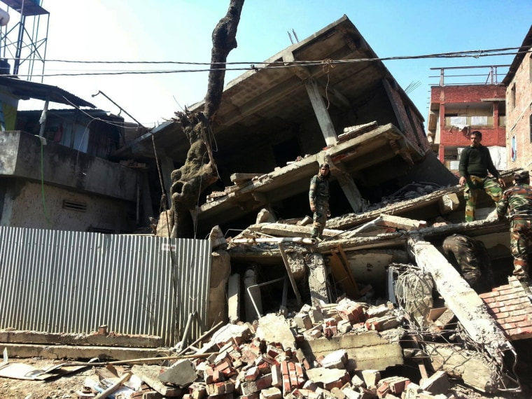 Soldiers inspect a house that collapsed in an earthquake in Imphal, capital of the northeastern Indian state of Manipur, on Jan. 4, 2016.