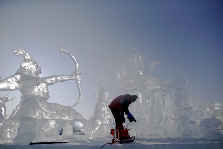 Image: A worker polishes an ice sculpture ahead of the Harbin International Ice and Snow Festival in the northern city of Harbin