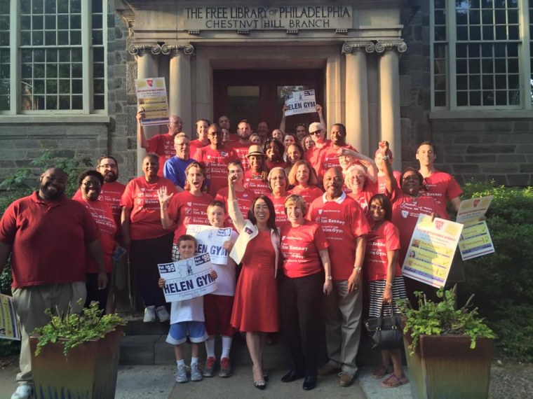 Helen Gym celebrates with supporters in front of a public library. Gym was elected to the Philadelphia City Council in 2015 on an education-focused platform. She is the first Asian-American woman to serve on the council.
