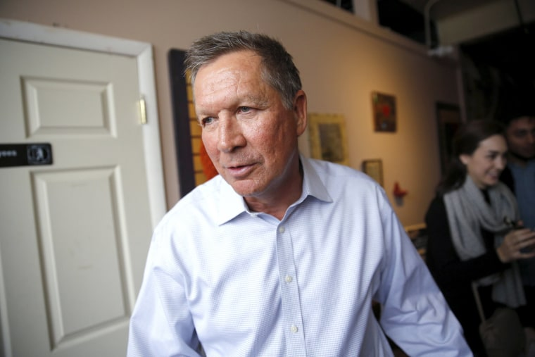 Image: Republican U.S. presidential candidate John Kasich walks out after a meet and greet at the Inspired Grounds Cafe as he campaigns in West Des Moines