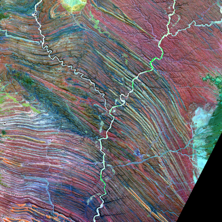 The Advanced Spaceborne Thermal Emission and Reflection Radiometer (ASTER) on NASA's Terra satellite captured this false-color image of the Ugab River in Namibia.