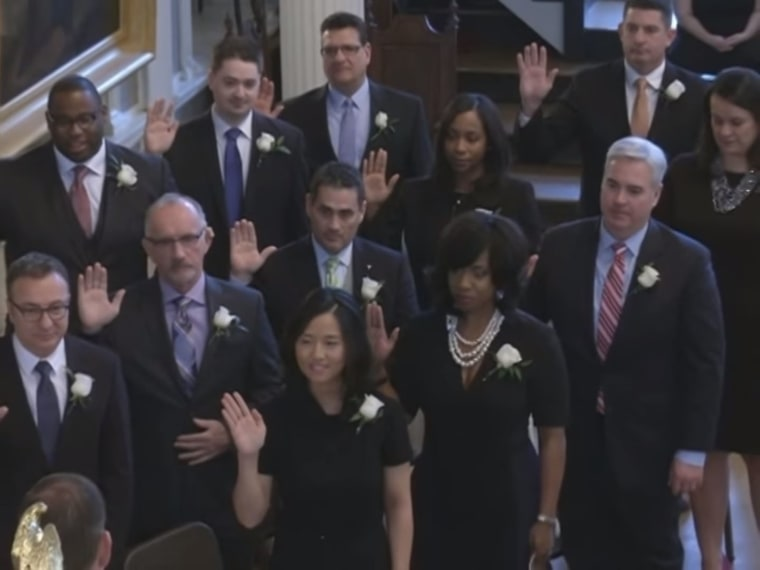 The Boston City Council being sworn in on Jan. 4, 2016. Michelle Wu (front) was elected president of the council and is the first Asian American to serve in that role.