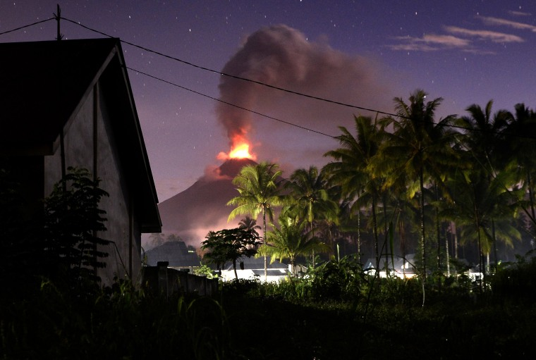 Image: Indonesia's Mount Soputan volcano spews lava and ash during an eruption as seen from Silian 3 village in Minahasa Tenggara