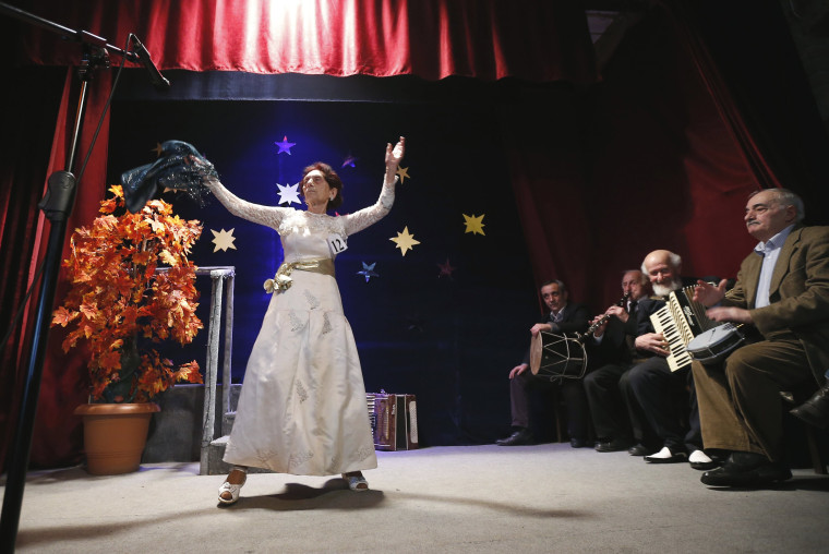 """Image: Maya Osipova performs during the \""""Super Grandmother and Super Grandfather\"""" contest in Tbilisi"""