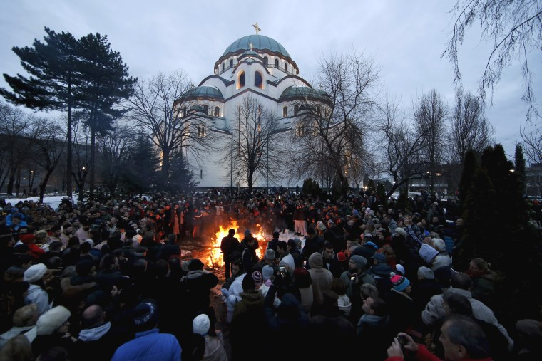 Image: Believers burn dried oak branches on Orthodox Christmas Eve in Belgrade