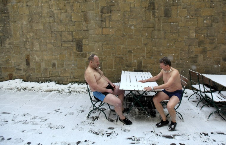 Image: Participants prepare for the traditional Three Kings swim to commemorate Epiphany at the Vltava River in Prague