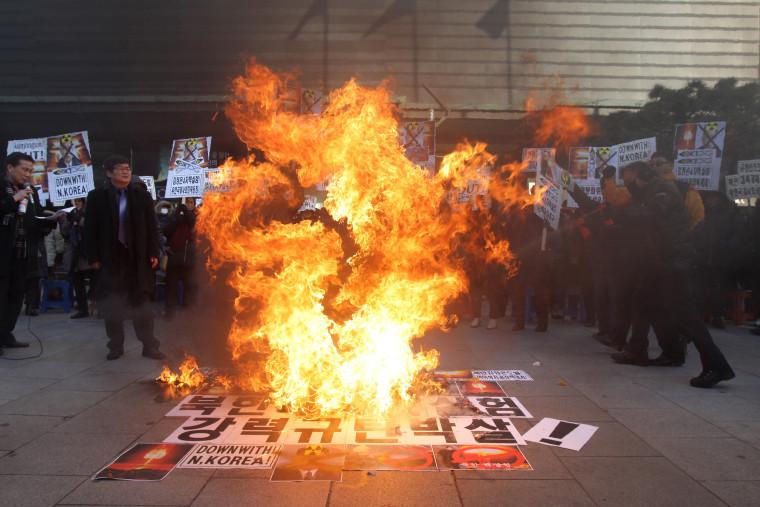 Image:Protesters burn an effigy of Kim Jong Un