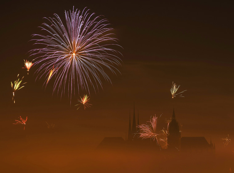 Image: Fireworks light the sky above the medieval Mariendom