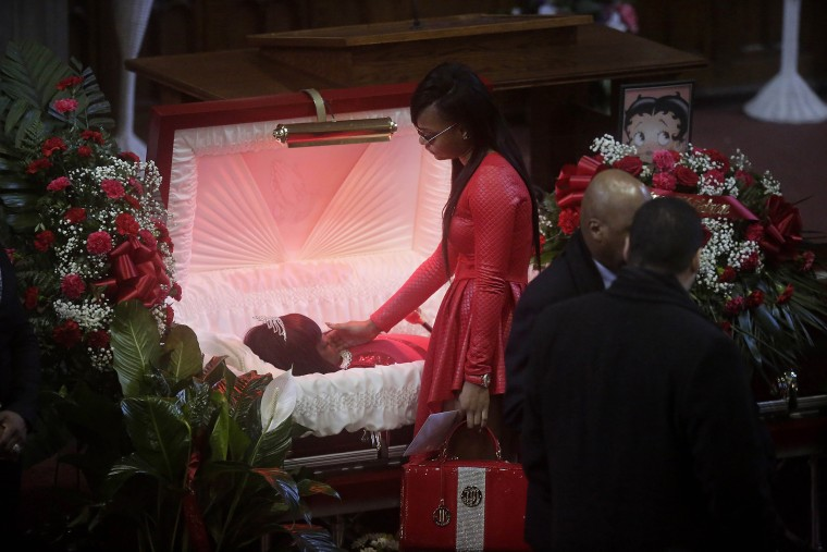 Image: LaTonya Jones stands over her mother Bettie Jones during her funeral