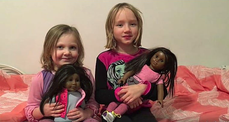 Katie Nachman's daughters hold the dolls they received for Christmas.