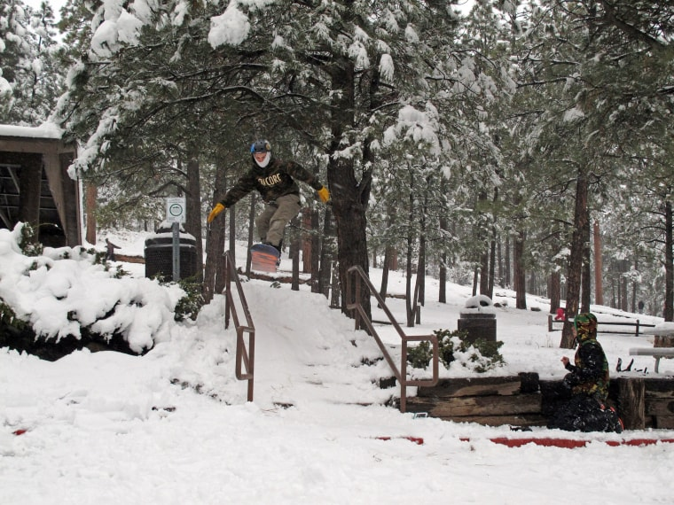 Image: Zach Bednar hits a ramp while snowboarding in Flagstaff, Ariz.