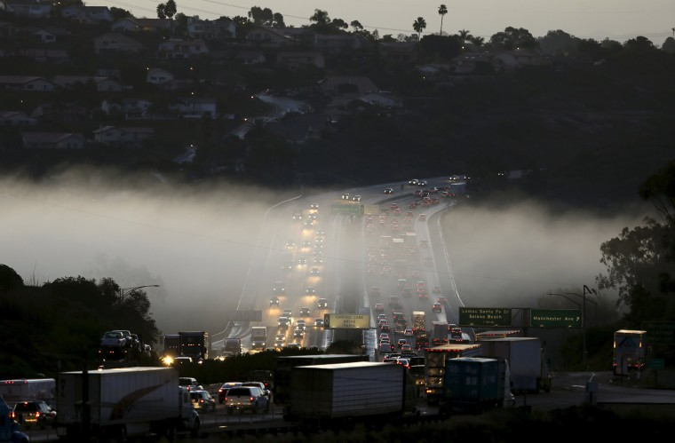 Image: Morning commuter traffic travels through a section of ground fog following an El Nino-strengthened storm in Solana Beach, Calif.