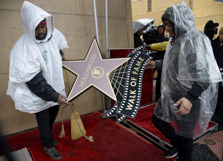 Image: Workers prepare for a Hollywood Walk of Fame ceremony in Hollywood
