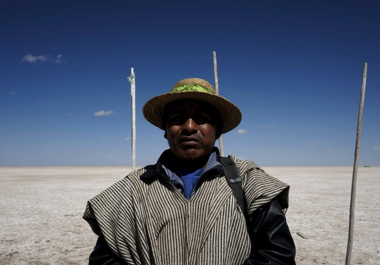 Image: Fisherman Rene Valero, from the Urus ethnic group, is seen at the dried Poopo lakebed in the Oruro Department, south of La Paz, Bolivia