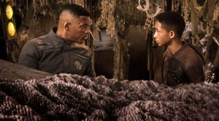 """Will Smith, left, and Jaden Smith star in Columbia Pictures' \""""After Earth.\""""  The movie is about a crash landing that leaves teenager Kitai Raige (Jaden Smith) and his legendary father Cypher (Will Smith) stranded on Earth, 1,000 years after cataclysmic events forced humanity's escape."""
