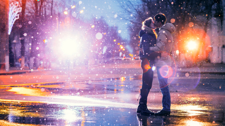 In love couple kissing in the snow at night city street. Filtered with grain and light flashing; Shutterstock ID 267543896; PO: today.com