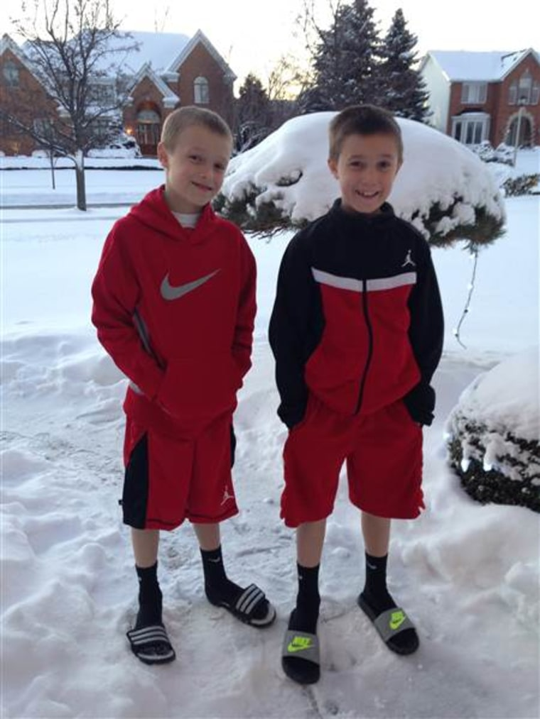 Eight-year-old twins Cameron, left, and Colin Corcoran show off their winter look in snowy Buffalo.