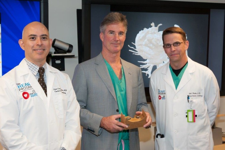Dr. Juan Carlos Muniz (left), Dr. Redmond Burke (center, holding Google Cardboard) and Dr. John Rhodes, all of Nicklaus Children's Hospital, collaborated on planning Teegan's surgery.