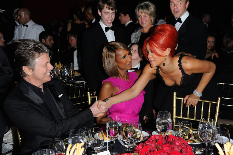 Image: Supermodel Iman (center) introduces her husband David Bowie to Rihanna