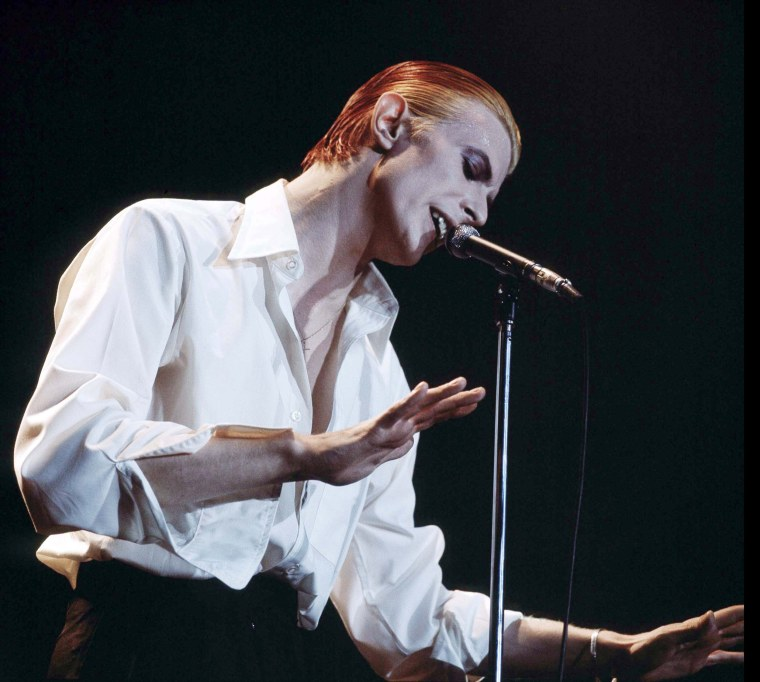 """Image: Singer David Bowie performing on stage as the """"Thin White Duke"""""""