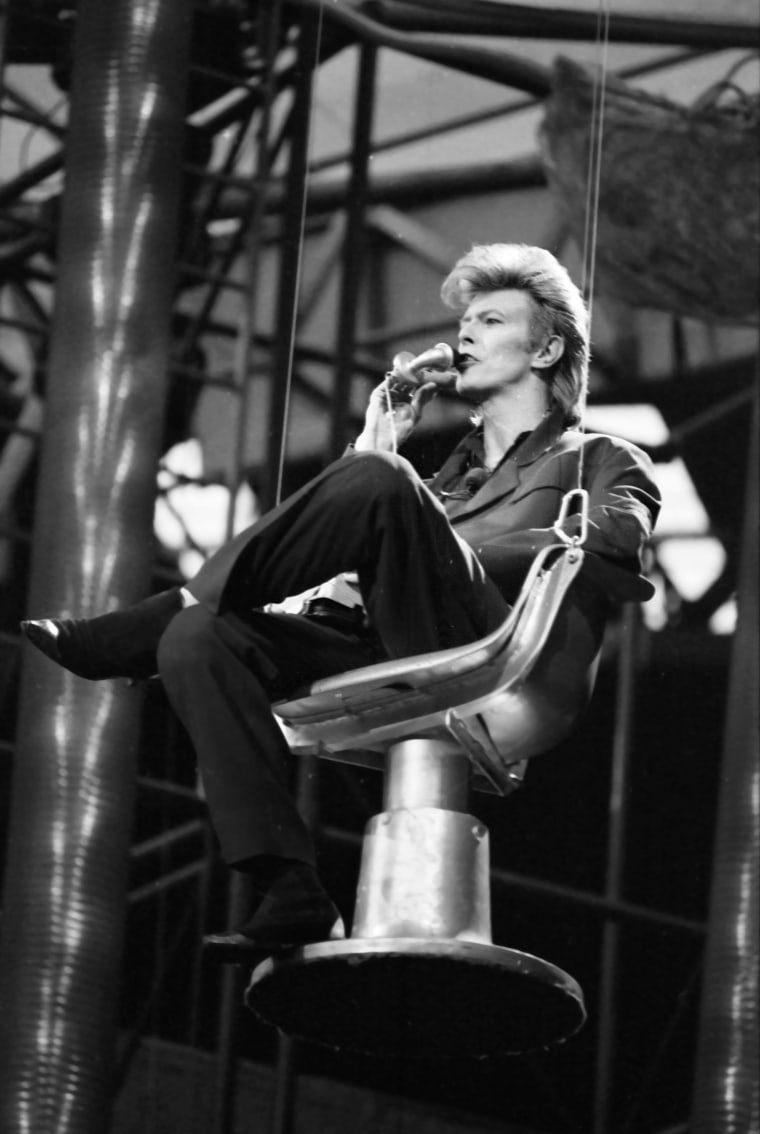 Image: David Bowie performs during his concert at Wembley Stadium in June 1987