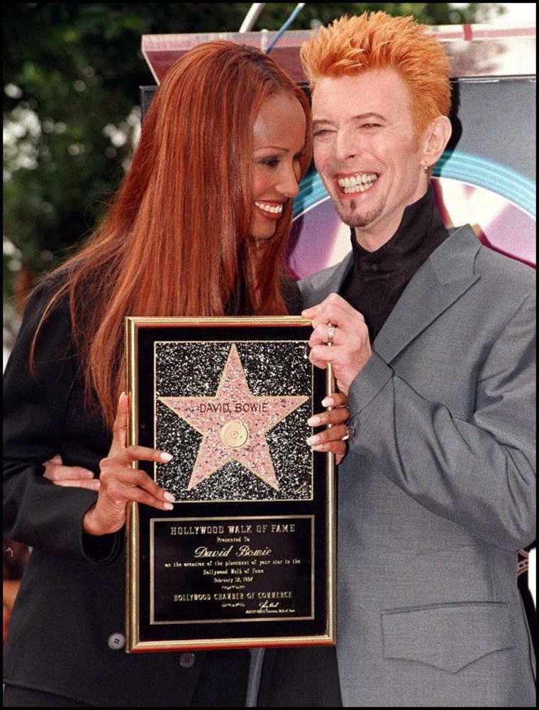 Image: Bowie and his wife Iman smile in Feb. 1997