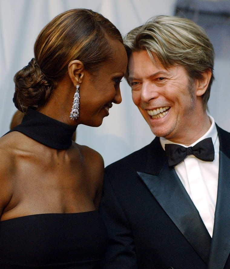 Image: Iman and Bowie arrive at the Council of Fashion Designers of America Fashion Awards in New York on June 3, 2002.