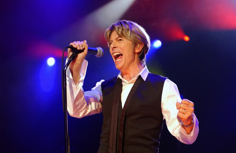 Image: Bowie performs in Paris on July 1, 2002.