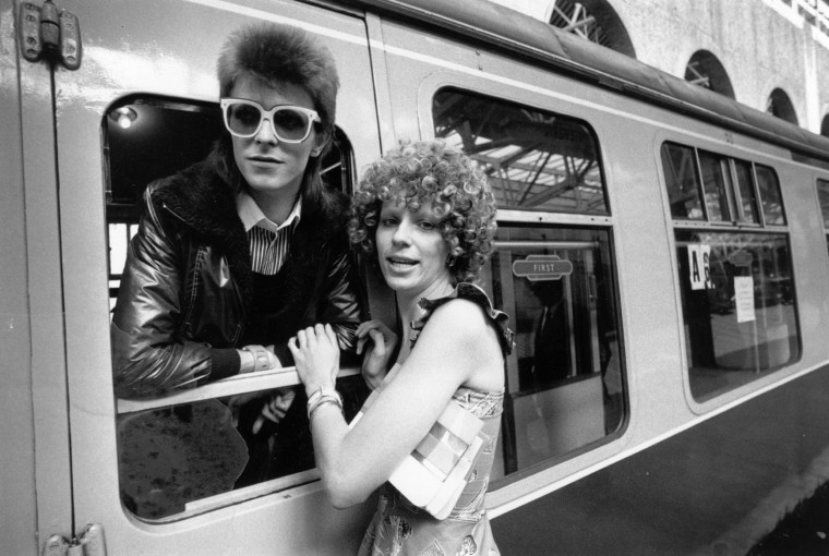 Image: Bowie is seen off at a station by his wife Angie on July 9, 1973.