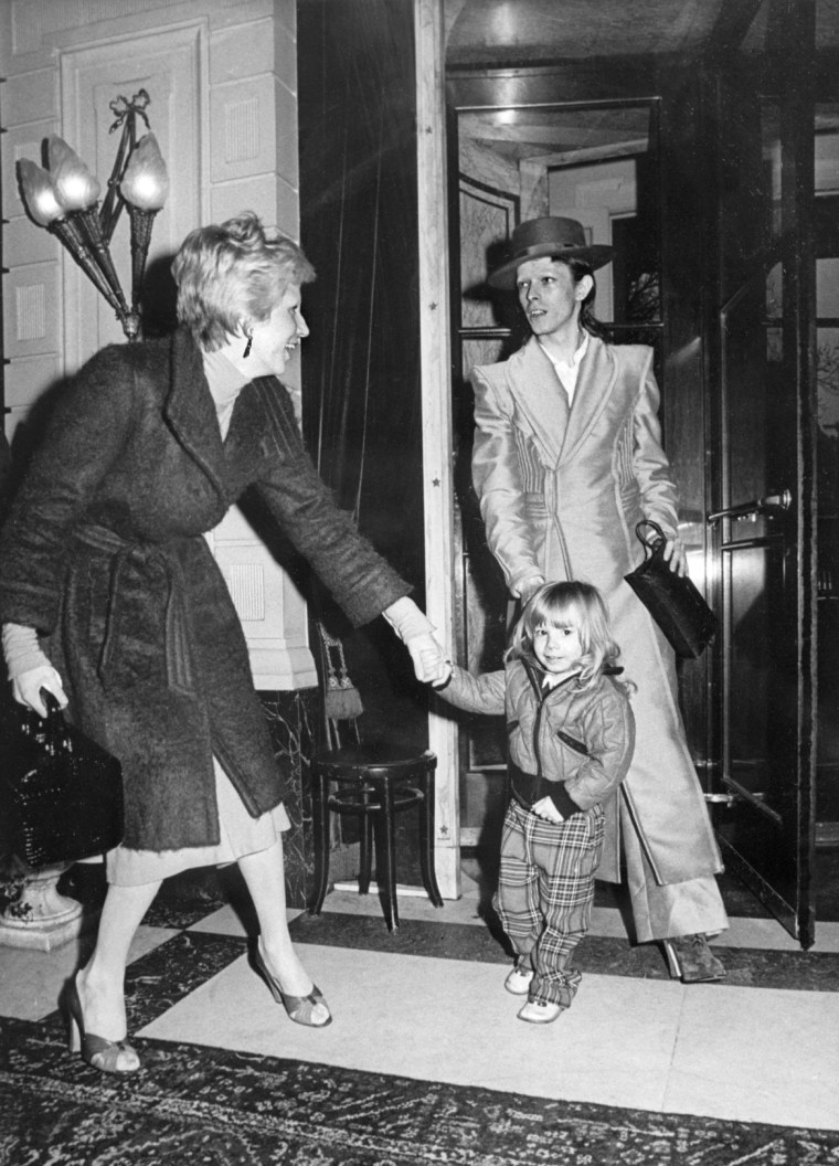 Image: Bowie with his wife Angie and son in 1974