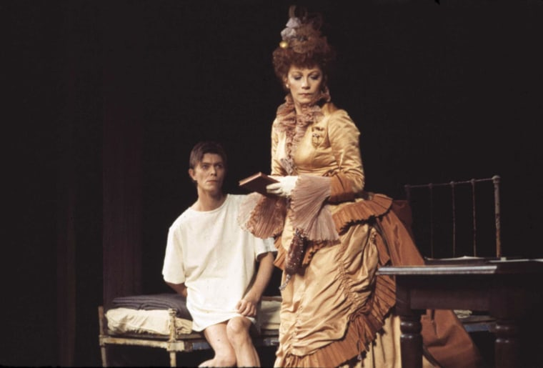 """Image: Bowie rehearses a scene in the Broadway show \""""The Elephant Man\"""" with co-star Patricia Elliott on Sept. 17, 1980"""